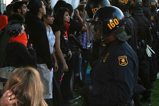 Police separate protesters in Berkeley, California. (Image: John Martinez Pavliga via Wikimedia Commons)