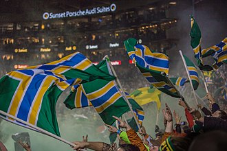 Flag of Portland, Oregon - Fans waving the flag at a Portland Timbers (Major League Soccer) Game.