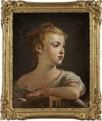 Porträtt av ung flicka med fågelbur