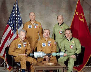 Vance D. Brand - Brand (seated center) poses with the rest of the American and Soviet crew of Apollo-Soyuz