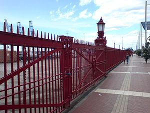"Ports of Auckland - The iconic ""Red Fence"", the southern edge (customs border) of Captain Cook wharf, on Quay Street."