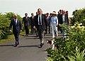 President George H. W. Bush and Barbara Bush greet King Hussein of Jordan.jpg