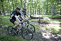 President George W. Bush and Prime Minister Anders Fogh Rasmussen of Denmark navigate a path at Camp David.jpg