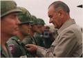 President Lyndon B. Johnson in Vietnam, Decorating a soldier - NARA - 192512.tif