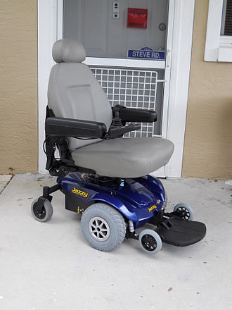 "Motorized wheelchair - A front-wheel-drive chair with a ""captain's chair"" seat"
