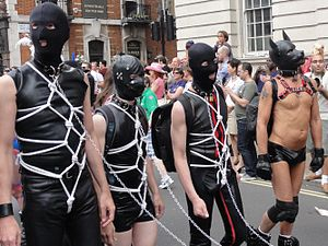 Rubber and PVC fetishism - Men in latex gear marching down Whitehall as part of Pride London 2011.