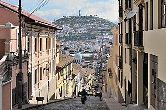 El Panecillo - The El Panecillo hill seen from Quito's historic centre along the García Moreno street