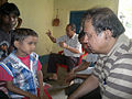 Rajesh 9 yr old with hydrocephalus & low vision- Jamunanaki CBR camp- Kuarmunda (9994087846).jpg