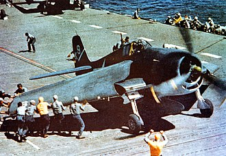 "Grumman F6F Hellcat - An F6F-3 aboard USS Yorktown has its ""Sto-Wing"" folding wings deployed for takeoff"