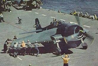 """Grumman F6F Hellcat - An F6F-3 aboard USS Yorktown has its """"Sto-Wing"""" folding wings deployed for takeoff"""