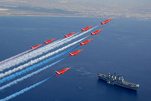 RAF Akrotiri - Red Arrows flying over HMS Illustrious next to Akrotiri