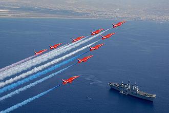 RAF Akrotiri - Red Arrows flying over HMS Illustrious next to Akrotiri