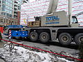 Removing the big boom crane from atop the almost finished reconstruction of the old National Hotel, 2015 03 07 (13) (16574103729).jpg