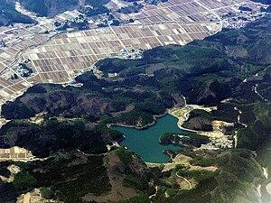 Fujinuma Dam - Fujinuma Reservoir in 2009 with dam at center bottom, auxiliary dam on left edge of reservoir