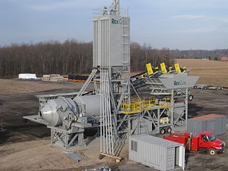 Concrete plant - RexCon Model S portable concrete paving plant with dual mixers can produce up to 55 loads of concrete per hour, or around 550 cubic yards per hour, from a single lane of traffic.