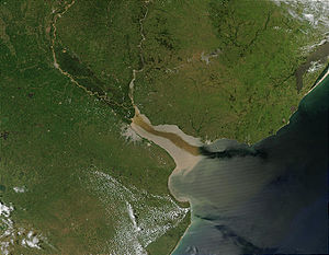 Río de la Plata - Satellite image of the Paraná and Uruguay rivers emptying into the Río de la Plata. Due to the relatively calm surface of the estuary and the angle of the Sun relative to the satellite, the current of the river flowing out into the Atlantic is visible.