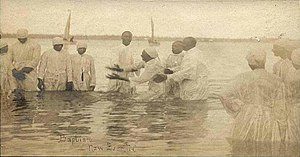 Immersion baptism - A full-immersion baptism in a New Bern, North Carolina river at the turn of the 20th century.