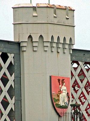 Runcorn Railway Bridge - Britannia shield on the western face of the bridge showing an LNWR loco and train crossing the linked viaduct.