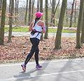 Running woman with braids and cap Marathon Rotterdam 2015.jpg