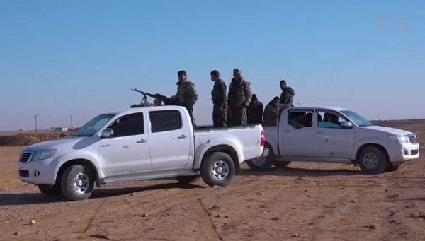 SDF technicals in northern Raqqa countryside (December 2016).png