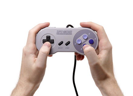 Miyamoto was responsible for the controller design of the Super Famicom/Nintendo. Its L/R buttons were an industry first and have since become commonplace. SNES-Controller-in-Hand.jpg