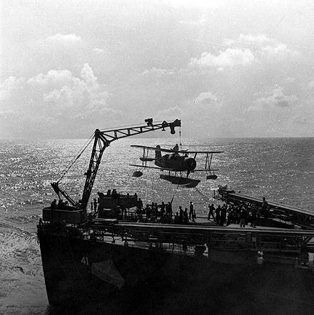 Cruiser launched Curtiss SOC Seagulls had a short life expectancy without fighter cover. SOC scoutplane is hoisted on board, during recovery by USS Philadelphia (CL-41).jpg