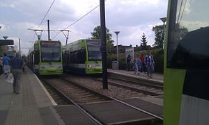 Sandilands tram stop - Trams waiting at Sandilands to reverse eastwards in 2011. Five years later, Tram 2551 (on the left) would be involved in a derailment in the area.