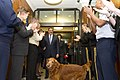 Secretary of Defense Leon E. Panetta and Sylvia Panetta, with their dog Bravo, exit the Pentagon on their last day, through crowds of cheering department of defense workers and military members (2).jpg