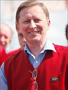 Sergei Ivanov, smiling, in red vest.JPG