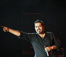 Shankar Mahadevan performing on the steps of the Asiatic