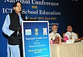 Shashi Tharoor addressing at the inauguration of the National Conference on ICT for School Education, in New Delhi on August 13, 2013. The Union Minister for Human Resource Development, Dr. M.M. Pallam Raju is also seen.jpg
