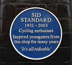 Photo of Sid Standard blue plaque