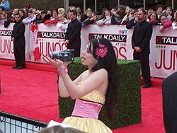 Skye Sweetnam with camcorder.jpg