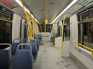 Bombardier Innovia Metro - Interior of Mk3 car looking toward the end. Notice one side of the seats are removed, and larger windows.