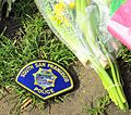 South San Francisco Police badge and Flowers for the Westminster Attack Parliament Square, 27 March 2017 (33644374366).jpg