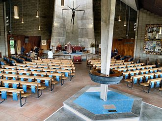 Church of St George, Letchworth - Interior of the church showing the circular concrete font