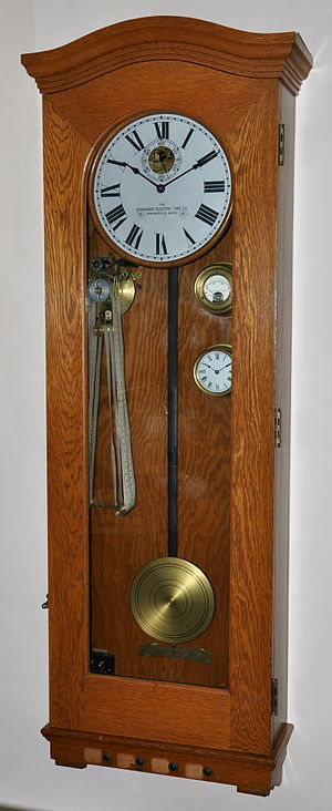 Electric clock - Master clock from synchronized school clock system. c.1928  Electromechanical movement winds each minute and impulses slave clocks each minute. Operates on 24 Volts DC