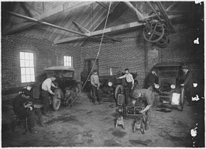 Students at work in auto repair shop - NARA - ...
