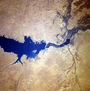 Lake Assad - Lake Assad (left), Tabqa Dam (centre), and Baath Dam (right). The photo was taken on STS-78, June 1996. North is in the upper left corner of the image.