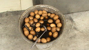 Tea egg - Tea eggs in a metal bowl over heat source. A common sight throughout China