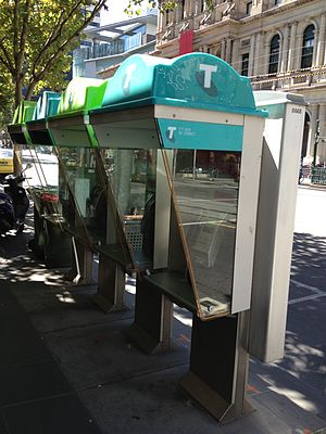 Telstra - Telstra phone booths showing the current colour scheme, replacing the former orange logo with shades of green and blue.