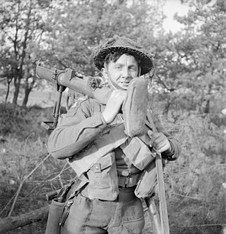 PIAT - A soldier of the Duke of Cornwall's Light Infantry carrying a PIAT, November 1944
