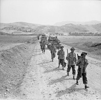 38th (Irish) Brigade - Universal Carriers and troops of the 6th Battalion, Royal Inniskilling Fusiliers, move up to Catenanuova, Sicily, August 1943.