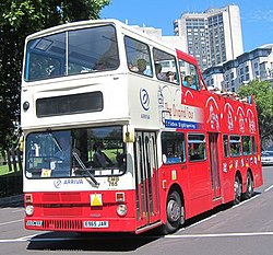 The Original Tour bus EMB765 (E965 JAR) 1988 Hong Kong tri-axle (CMB ML64, DV 4883), Wellington Arch, 26 June 2011.jpg