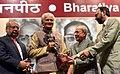 The President, Shri Pranab Mukherjee presenting the 51st Jnanpith Award to Dr. Raghuveer Chaudhary, at Parliament House, in New Delhi on July 11, 2016.jpg