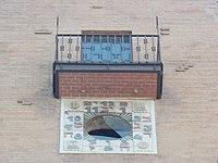 Three-story Art Nouveau house. Monument. ID 825. Former parish hall and school used by the Orthodox Jewish community. - Hebrew inscription Clock.- Budapest VII. Dob St. 35.JPG