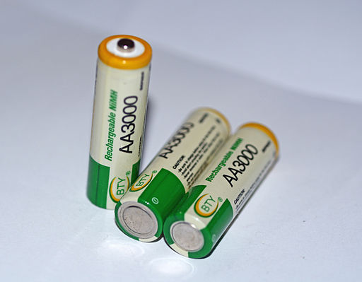 Three AA batteries on a white background