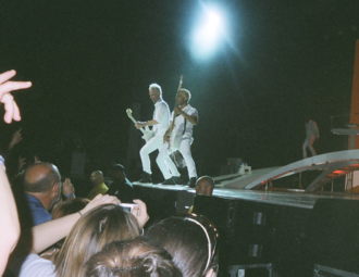 Tom Dumont - Dumont, along with Tony Kanal, during No Doubt's 2009 summer reunion tour.