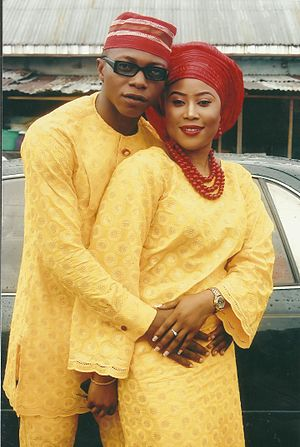 Yoruba culture - This an image of a marriage ceremony. the dress pattern in picture is typical of the yoruba ethnic group in Nigeria