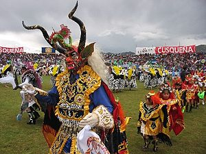 Devil of Puno, Dance that is practiced in the Peruvian highlands. Devil Puneno. Diablada punena during the Festival de la Candelaria in Peru. The Supay in Diablada Punena during the Festival of Candelaria. Lightsuits Trajesdeluces207.jpg